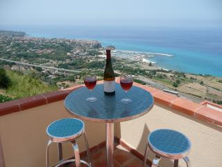 View of the beautiful town of Tropea from edge of private terrace