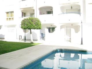 The pool is a short distance form apartment, as you can see here.