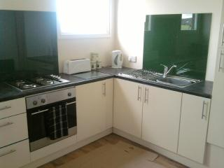 kitchen in Hillfort Lodge equipped with full oven, fridge/freezer, washing machine & dishwasher
