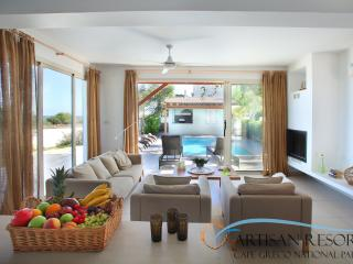 This pleasant living space opens up in various directions offering great outdoor views.