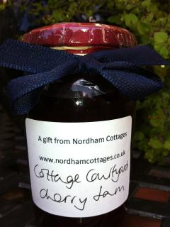 A jar of homemade preserve for you to take home, this jar made from the cherry tree in the courtyard
