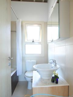 The en suite bathroom offers good ventilation and natural lighting.