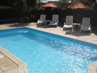 Heated swimming pool with loungers
