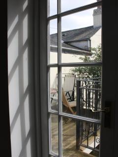 Doors onto the balcony.
