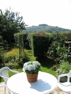 Patio and view of Buxbury Hill, garden now fenced for toddlers, gas BBQ and patio furniture.