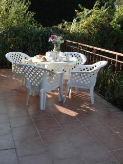 Enjoy breakfast on the terrace leading from lounge