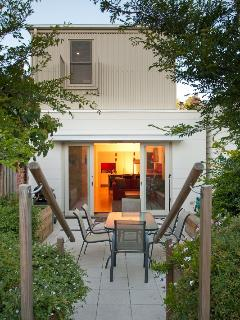 Lovely courtyard garden with ourdoor seating and barbeque