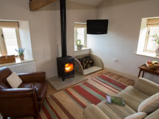 Beautifully appointed sitting room with stunning views over hay meadows,many original features..