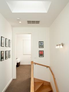 Light filled stairwell and upstairs hallway.