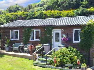 THE LOG CABIN, romantic, country holiday cottage, with a garden in Adforton, Ref