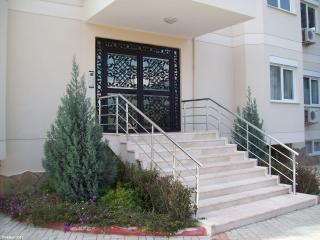 the block's main entrance, with attractive wrought-iron door - there is ground level access too
