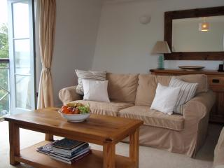 A bright and inviting lounge with solid oak furniture with stylish and comfortable seating for five.