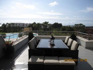 Relaxing views over the pool and the sea sitting on the large terrace