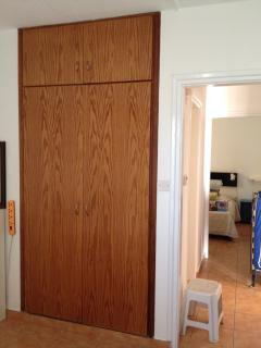 wardrobe in Bedroom 1 and lobby area giving access to bathroom and bedroom 2