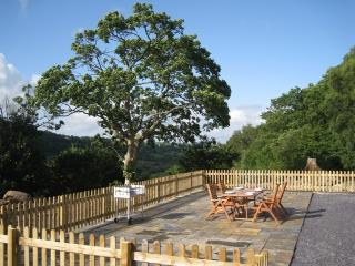 Enjoy a glass of wine on the patio, with beautiful countryside views across the valley