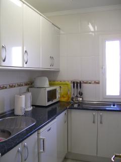 Fully fitted Kitchen with fridge, hob, microwave, kettle etc