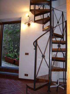 The spiral staircase and the front door on the ground floor