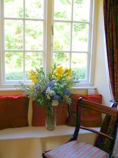 A green outlook from the living room at Avalon Cottage Glastonbury