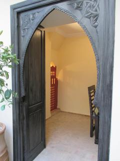 Carved door toward the dining room