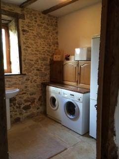 Utility/shower room with washing machine, tumble dryer and fridge/freezer