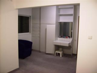 Dressing room off master bedroom can accommodate an extra bed