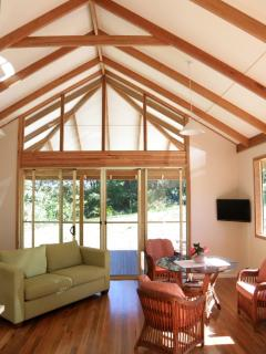 living area exposed rafters beautiful polished floors
