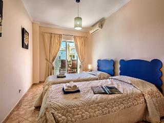 Singles bedroom with direct access to the terrace