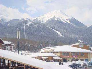 View of gondola station and piste from apartment balcony