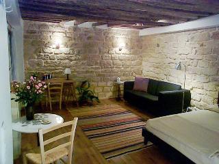 17th century stone walls and oak beams characteristic of the Marais.