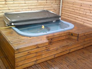 Hot tub os  filled with hot spring water from the farm