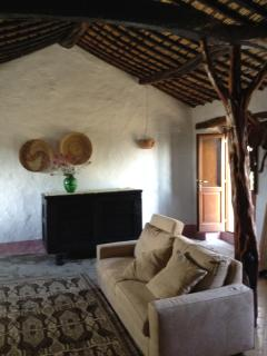 livingroom with original wooden beams and bamboo roof