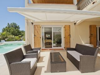 Outdoor Wicker Furniture under sun blind