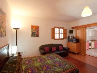 dormitorio y cocina con horno, Atirma