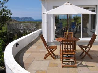 Sheltered natural stone patio, views of Horn Head, table, chairs & bbq available