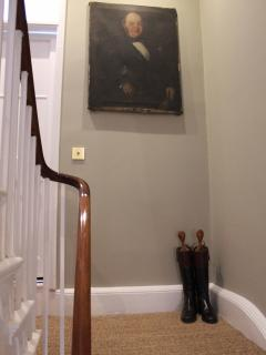 Staircase with fine art and oil paintings feature throughout
