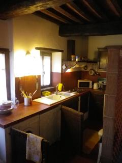 Kitchen is well equipped and settings for six.  Washer, Dishwasher, large refrigerator/freezer