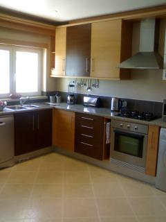 Fully equipped kitchen with modern new appliances