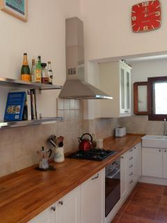 Large kitchen for family catering, with dishwasher and washing machine