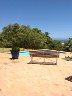 The view from the flat across the pool to the sea and the peninsular