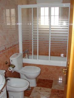 Family size bathroom, with Bidet, bath with overhead shower.