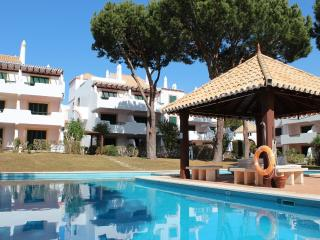Ground floor 2 bedroom apartment with pool, private garden and terrace