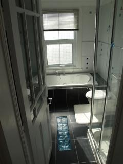 Enjoy a long soak in the jacuzzi bath or a quick shower in the separate shower