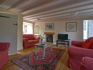 Snuggle up in front of the wood burner in the sitting room.
