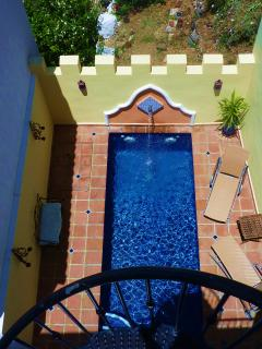 Private pool patio from large sunbathing roof terrace reached by spiral stairs from living room