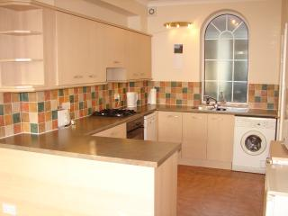 Fully fitted Kitchen with washing machine and dishwasher.