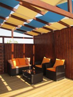 Covered decked area to left of Villa