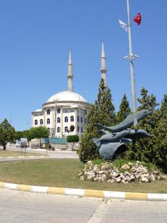 The nearby mosque, and dolphin statue on the roundabout