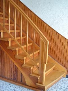 A hand-crafted feature staircase leads to the upper floor.