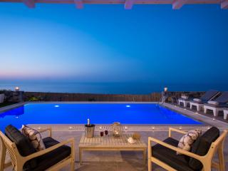 Glass of Champagne by night at the sunteracce and overwhelming view at  Villa Seaview