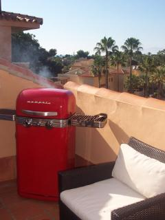 The retro gas BBQ on the west facing terrace with sea views and mountain views; great for evening